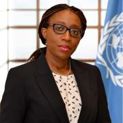 Photo of Vera Songwe with a UN flag in the background